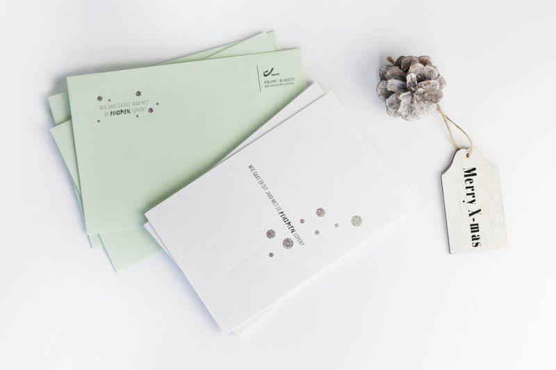 Teaserkaart van Buroform met glitter folie als sneeuwvlokken. Zalig kerstmis